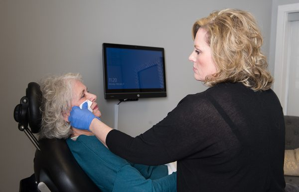 Nurse injector caring for a patient receiving cosmetic facial injectables in Nashville